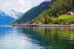 Moorage on fjord shore. In Norway Stock Photography