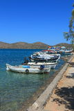 Moorage wall with boats Stock Images