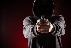 Moordenaar met kanon stock foto's