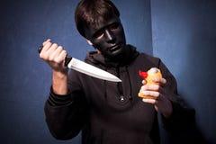 Moordenaar met masker Royalty-vrije Stock Foto's