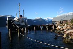 Moored. A junky old ship moored in Britannia Beach, BC royalty free stock image
