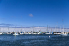 Moored and anchored sailboats in the Monterey Bay, California, USA Stock Photo