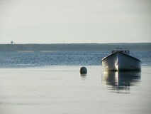 Moored boat in calm tidal water Stock Photography