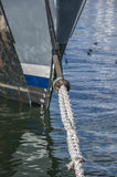 Moored Boat. Head Line or Hawser of a moored boat tied up to a pier in Cape Town's  Table Bay Harbour Stock Photo