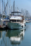 Moored boat and its reflection. In marina Royalty Free Stock Photo