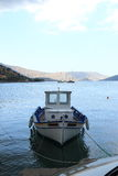 Moored boat on water Royalty Free Stock Photo