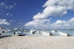 Moored boats and catamarans on the coast of the Caribbean Sea royalty free stock photo