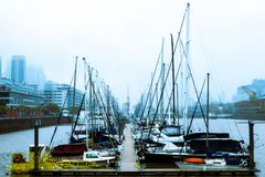 Moored boats in harbour stock photo