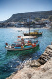 Moored boats at Matala beach in Crete Island, Greece Stock Photo