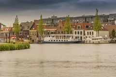Moored boats and houses in alkmaar. netherlands holland stock image