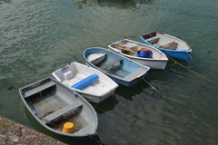 Moored boats. Rowing boats moored in harbour Stock Photo