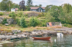 Moored boats, rural landscape, pasture and farm buildings. Stock Photography