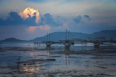 Moored boats in Sape village in Sumbava. Moored boats after sunset in a small fishing village Sape in Sumbava Island, Indonesia Stock Photo