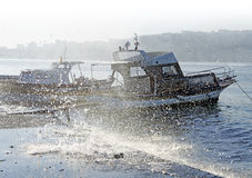 Moored boats in stormy weather Stock Images