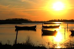 Moored boats in the sunset Royalty Free Stock Photography