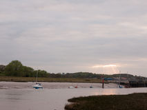 Moored boats and yachts at low tide on Wivenhoe Estuary in Essex Royalty Free Stock Photography