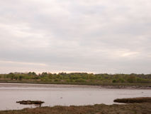Moored boats and yachts at low tide on Wivenhoe Estuary in Essex Royalty Free Stock Photos