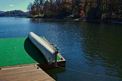 Moored Canoe on a Dock Royalty Free Stock Photos