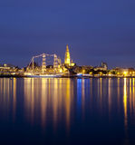 Moored at the cathedral. Illuminated sail ship during the Tall Ships Race in Antwerp Stock Image
