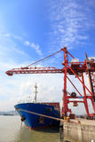 Moored container ship in a harbor Royalty Free Stock Images