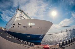 Moored cruise liner in sunny day, fish eye distortion royalty free stock image