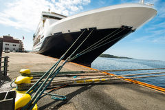 Moored cruise ship ropes. Prow front view of a large cruise liner ship Royalty Free Stock Photos
