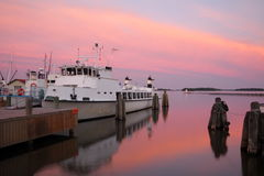 Moored ferry in the sunset. Sunset over the archipelago with a small ferry stock image