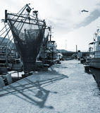 Moored fishing boats with drying nets Royalty Free Stock Photography
