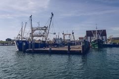 Moored fishing trawlers at pier. Oudeschild Texel, The Netherlands, October 13, 2018: moored fishing trawlersat pier royalty free stock photos