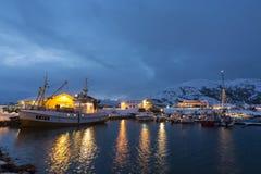 Moored fishingboat wintertime Sommarøy Norway. Moored fishingboat and leisureboats wintertime at Sommarøy. North Atlantic coast. Troms Fylke, Northern Stock Photography