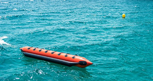 Moored floating banana boat at sea Royalty Free Stock Photos