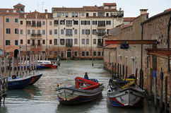 Moored gondolas and boats to the pier in Venice, Italy Royalty Free Stock Photography