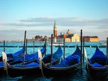 Moored gondolas and San Giorgio di Maggiore stock images