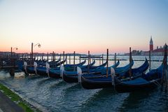 The moored gondolas at San-Marko Embankment at sunrise. Venice, Italy Royalty Free Stock Images