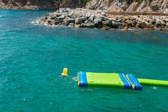 Moored inflatable beach mattress Royalty Free Stock Images
