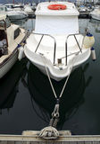 Moored motor boat Stock Images
