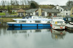 Moored motor boat and canal boat Stock Image