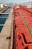 Moored oil tanker pipeline. Crude oil tanker moored at oil terminal Royalty Free Stock Images