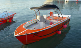 Moored pleasure boat orange in the fishing bay Royalty Free Stock Images