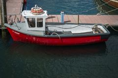 Moored red small fishing boat Stock Photo