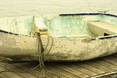 Moored rowing boat. Old rowing boat moored by water Royalty Free Stock Photo