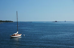 Moored Sail Boat. A sail boat at a mooring in the ocean Stock Photography