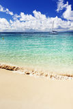 Moored sail boat off a Caribbean Sea beach Stock Photo
