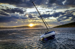Moored sailboat in heavy winds Royalty Free Stock Image