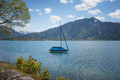 Moored sailboat at lake tegernsee. In springtime landscape Royalty Free Stock Photos