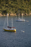 Moored Sailboats Near Cliff Stock Photography
