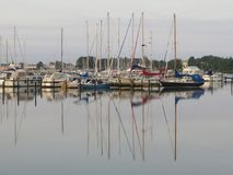 Sailing boats in late afternoon sun Royalty Free Stock Photos
