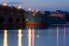 Moored ship to the pier at sunset. Evening view of the pier of the first lock of the Volga-Don Canal named after Lenin, Volgograd Stock Image