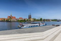 Moored ship to the wharf, in the background a view of Ostrow Tumski. Wroclaw, Poland royalty free stock photography