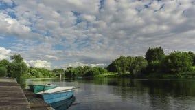 Moored small rental boats. Summer river Stock Photos